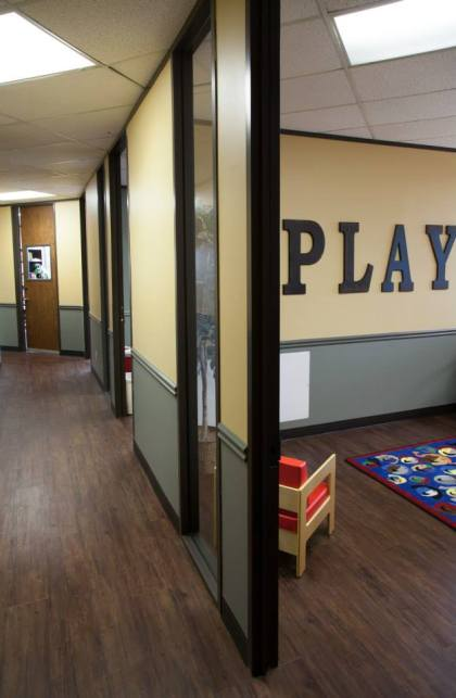 Office Hallway with Play Sign
